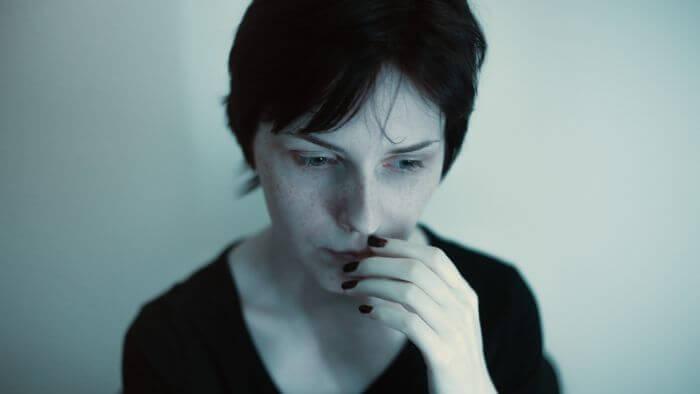Dark expression woman biting her lips