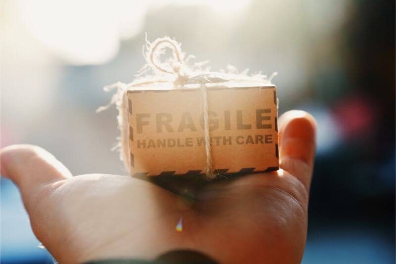 Small fragile box on palm