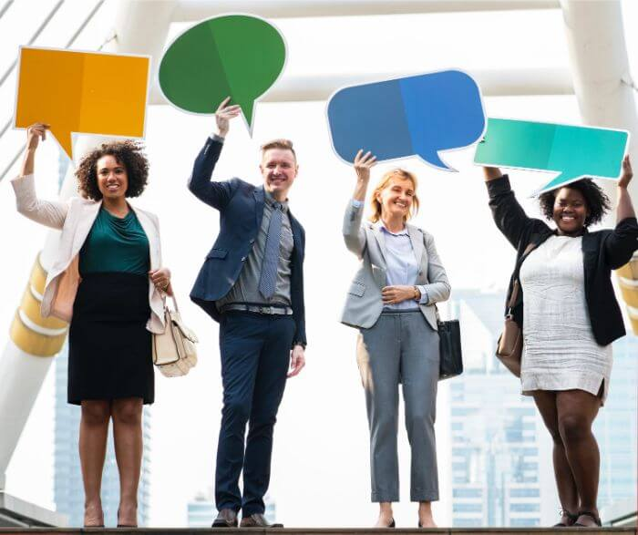 Four men and women with a panel of speech bubbles