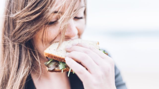 woman eating sandwich
