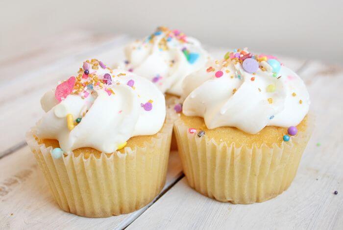 Three cupcakes with plenty of fresh cream