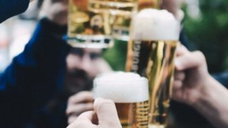 Toasting with beer mugs